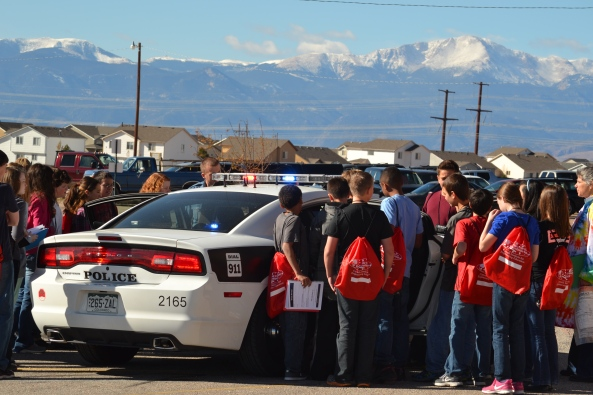 Campers check out the police car