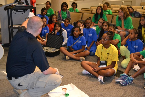 Sean Kearney, Dallas PD, displays evidence to campers.